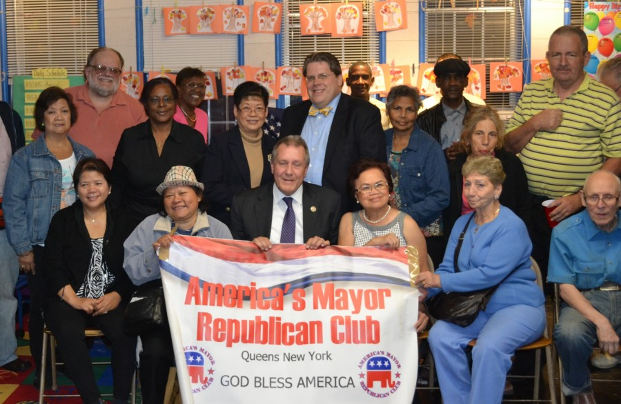 Democratic City Council Member Daniel Dromm (Jackson Heights, Elmhurst) poses with members of the America's Mayor Republican Club, including leader Myrna Littlewort and Club President Ray Hummel at their meeting in Jackson Heights.