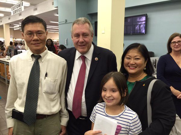 Council Member Dromm (middle), the author, at the Queens Library.  Photo courtesy of the Gotham Gazette.