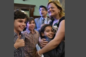 City Council Speaker Melissa Mark-Viverito hugs a student from the Lower East Side's Earth School during a meeting to brainstorm ways to advocate for an LGBT-inclusive curriculum in their elementary school.