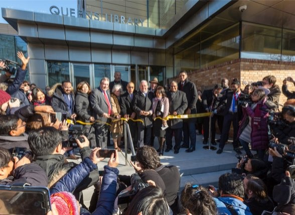 Courtesy of NYC Department of Design and Construction. Hundred of Elmhurst residents wach elected and Queens Library officials cut the ribbon opening the new Elmhurst Community Library.