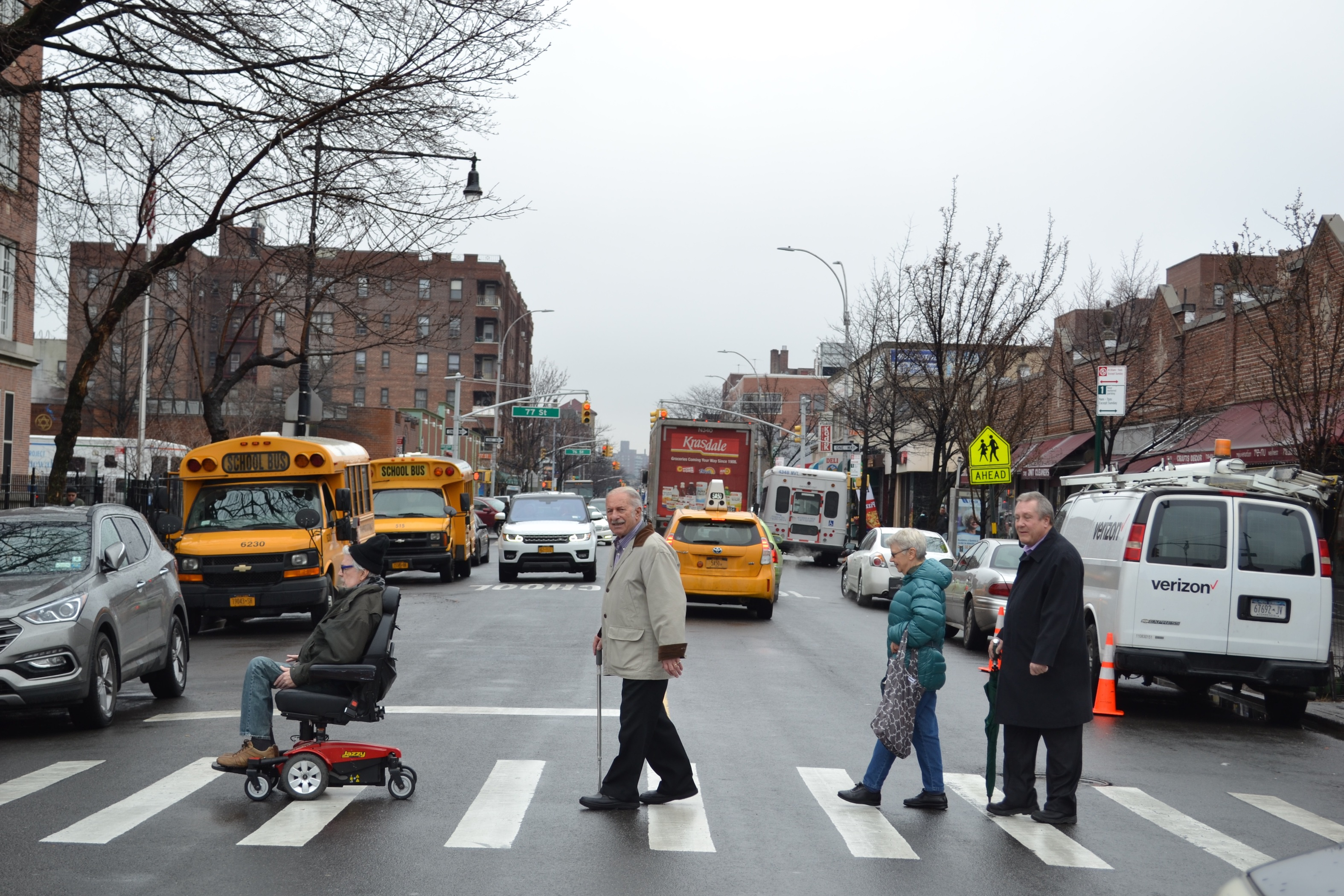 David Sargent, Joseph Ricevuto, Jacqueline Sung, and NYC Council Member Daniel Dromm cross 37th Avenue in Jackson Heights.